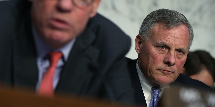 WASHINGTON, DC - NOVEMBER 01:  Committee Chairman Sen. Richard Burr (R-NC) (R) listens as Committee Vice Chairman Sen. Mark Warner (D-VA) (L) speaks during a hearing before the Senate (Select) Intelligence Committee November 1, 2017 on Capitol Hill in Washington, DC. The committee held a hearing on