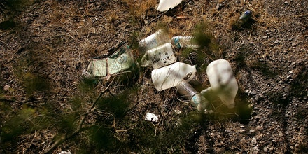 Empty water jugs litter the ground on a trail used by migrants entering the U.S. illegally from Mexico June 16, 2006 in Pima County, Arizona. Since 1998 over 2,650 men, women and children have died attempting to cross the U.S.-Mexico border. According to the U.S. Border Patrol, a record 473 illegal immigrants died while trying to cross the U.S.-Mexico border during the fiscal year that ended September 30, 2005. The group No More Deaths runs 24-hour camps in the desert conducting search and rescue patrols for migrants in distress.  (Photo by Spencer Platt/Getty Images)