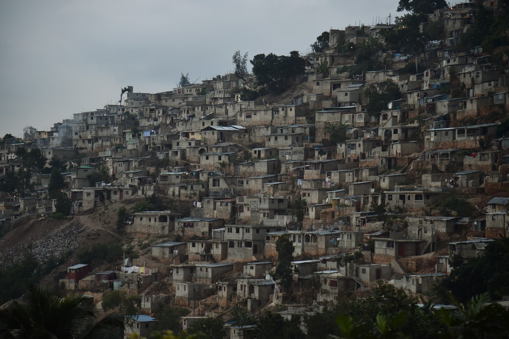 View of houses on a mountain in Juvenat, in the commune of Petion-Ville, in Port-au-Prince, on December 12, 2017. / AFP PHOTO / HECTOR RETAMAL        (Photo credit should read HECTOR RETAMAL/AFP/Getty Images)
