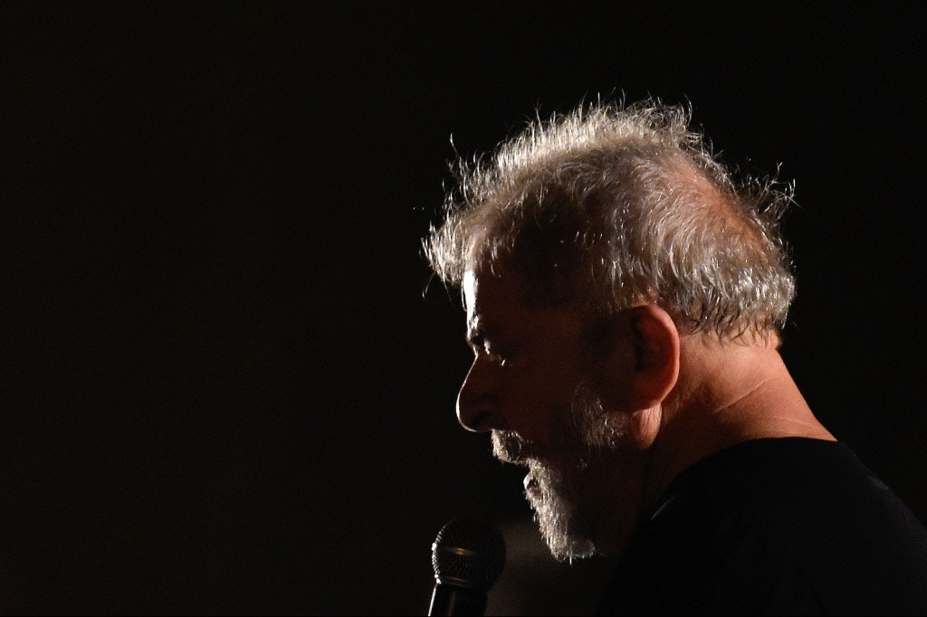"Former Brazilian President Luiz Inacio Lula da Silva addresses supporters during his visit to Station Square, in Belo Horizonte, as part of his ""Lula for Brazil"" bus tour campaign, in Minas Gerais, Brazil on October 30, 2017. Lula da Silva embarked on his most audacious challenge yet: to recapture the presidency -- and avoid prison. The presidential election won't take place until October 2018 and the many potential candidates are still keeping below the radar. Campaigning is not even officially allowed. / AFP PHOTO / DOUGLAS MAGNO (Photo credit should read DOUGLAS MAGNO/AFP/Getty Images)"