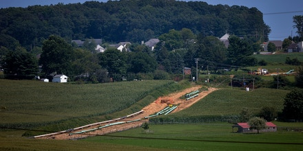 Sections of pipe sit at an Energy Transfer Partners LP construction site for the Sunoco Inc. Mariner East 2 natural gas liquids pipeline project near Morgantown, Pennsylvania, U.S. on Aug. 4, 2017. The Pennsylvania Department of Environmental Protection has issued four notices of violation after