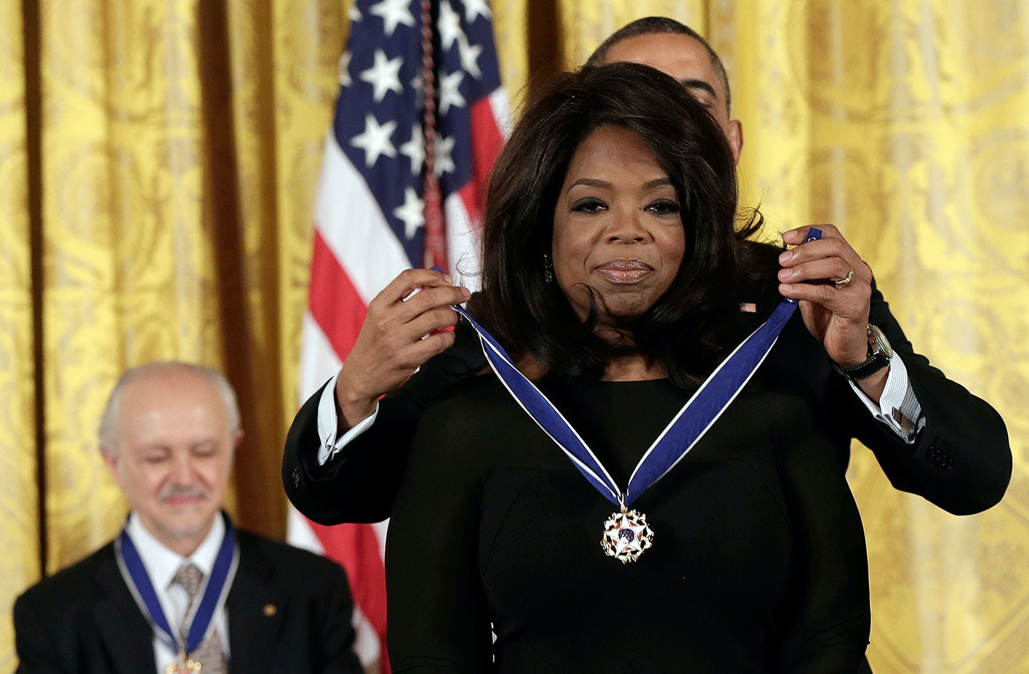 WASHINGTON, DC - NOVEMBER 20:  U.S. President Barack Obama awards the Presidential Medal of Freedom to Oprah Winfrey in the East Room at the White House on November 20, 2013 in Washington, DC. The Presidential Medal of Freedom is the nation's highest civilian honor, presented to individuals who have made meritorious contributions to the security or national interests of the United States, to world peace, or to cultural or other significant public or private endeavors. Also pictured is Mario Molina (L). (Photo by Win McNamee/Getty Images)