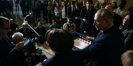 WASHINGTON, DC - NOVEMBER 14:  Senate Minority Leader Charles Schumer (D-NY) and Sen. Maria Cantwell (D-WA) (R) talk to reporters following the weekly Senate Democratic policy luncheon in the U.S. Capitol November 14, 2017 in Washington, DC. Senate Republicans are considering including a repeal of the Obamacare individual mandate as part of their proposed tax cut and reform legislation, which they want to pass the week after the Thanksgiving holiday.  (Photo by Chip Somodevilla/Getty Images)