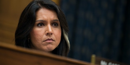 WASHINGTON, DC - NOVEMBER 01: Rep. Tulsi Gabbard (D-HI) listens to testimony from Thae Yong-ho, former chief of mission at the North Korean embassy in the United Kingdom, during a House Foreign Affairs Committee hearing on Capitol Hill, November 1, 2017 in Washington, DC. Yong-ho defected from North Korea in 2016. (Drew Angerer/Getty Images)