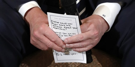 President Donald Trump holds notes during a listening session with high school students and teachers in the State Dining Room of the White House in Washington, Wednesday, Feb. 21, 2018. Trump  heard the stories of students and parents affected by school shootings, following last week's deadly shooting in Florida. (AP Photo/Carolyn Kaster)