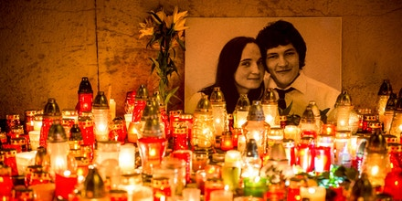 Hundreds of candles have been placed in front of a portrait of Slovak investigative journalist Jan Kuciak and his girlfriend Martina Kusnirova in the center of Bratislava in the night of February 27, 2018. The body of Jan Kuciak, a 27-year-old reporter for the aktuality.sk news portal owned by Axel Springer and Ringier, was discovered alongside that of Martina Kusnirova at their home in Velka Maca, 65 kilometres (40 miles) east of the Slovak capital Bratislava on February 26, 2018. / AFP PHOTO / VLADIMIR SIMICEK (Photo credit should read VLADIMIR SIMICEK/AFP/Getty Images)