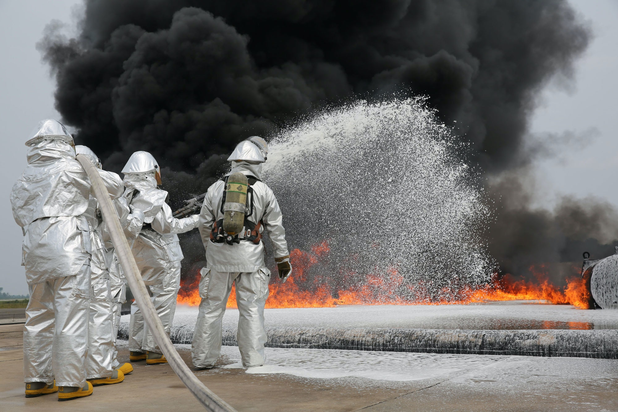 Marines with Bulk Fuel Company, 8th Engineer Support Battalion, 2nd Marine Logistics Group use Twin Agent Units to extinguish a blaze during a live fire training exercise aboard Marine Corps Air Station Cherry Point, Aug. 28, 2013. TAUs combine dry chemicals with water to create a foam that chokes the oxygen from a fire, stunting its growth and effectively ending it. (U.S. Marine Corps photo by Lance Cpl. Shawn Valosin)
