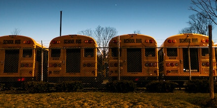 A fleet is buses is parked at the back of Brentwood High School after a hectic day. The demand of buses increased considerably after the murders of Nisa Mickens and Kayla Cuevas, with parents who wouldn't let their kids walk to school.