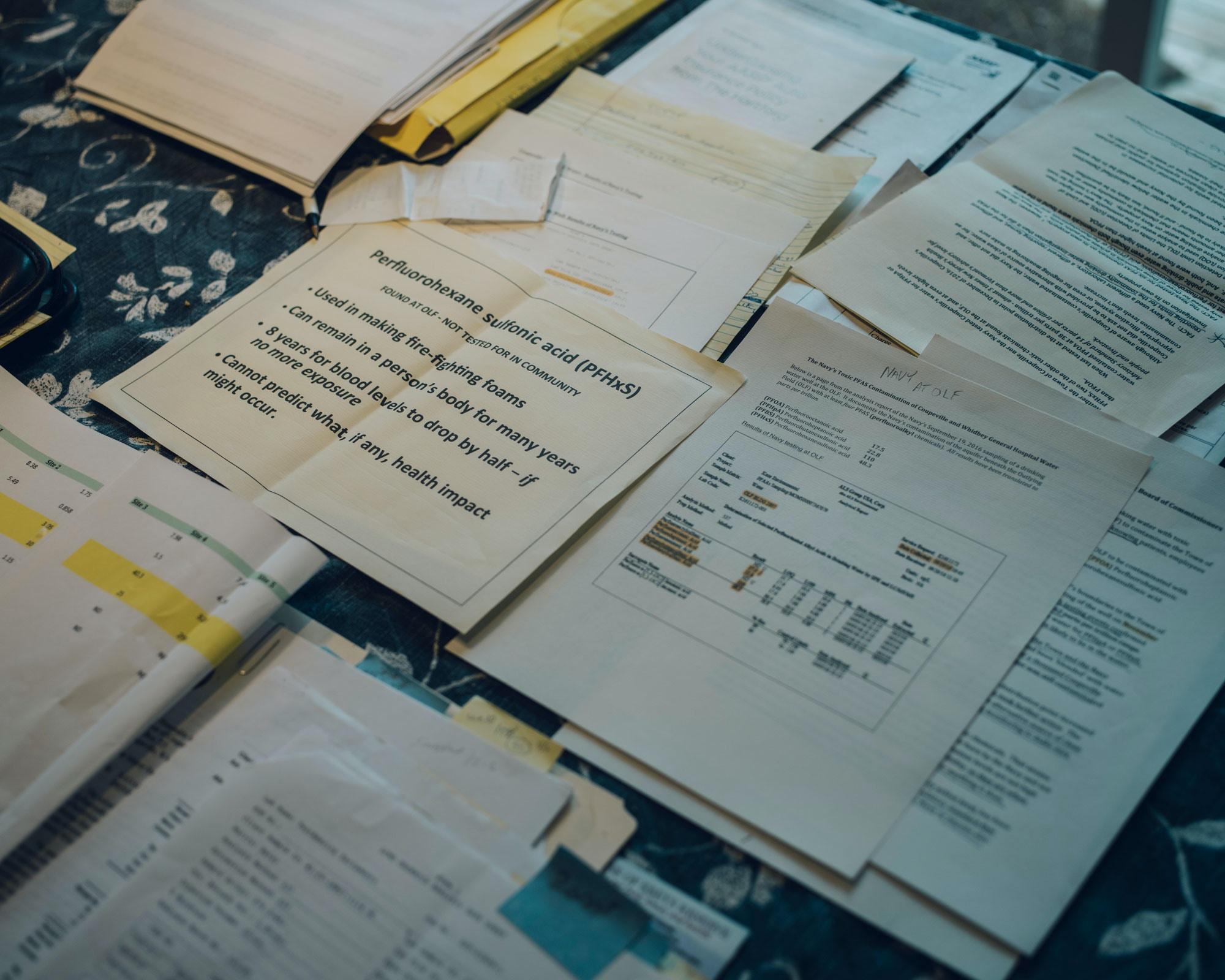 Test papers and information sit on Richard Abraham's desk in his home in Greenbank on Whidbey Island, Washington on July 13, 2017.