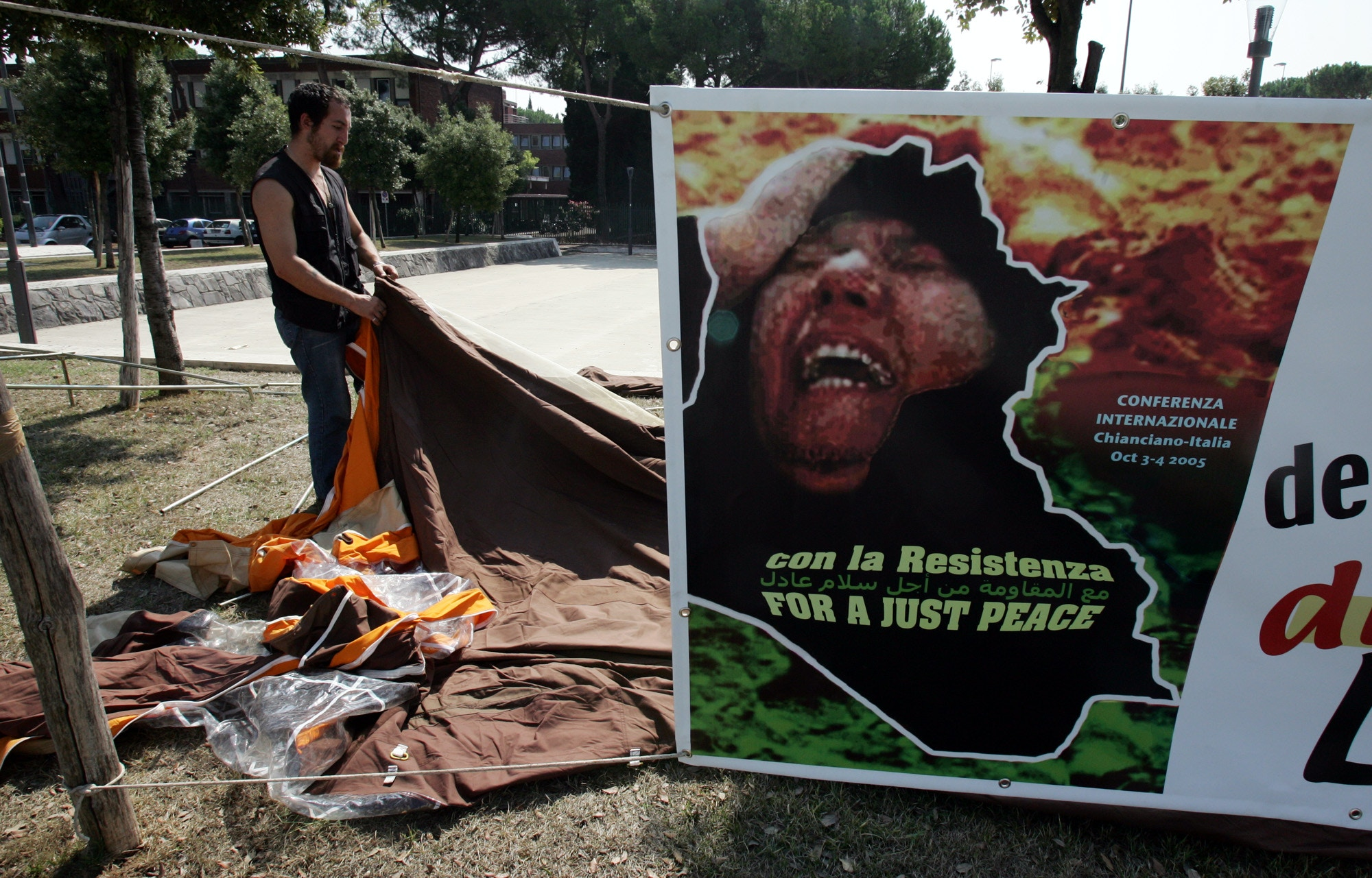 An anti-imperialist activist sets a tent in front of the Italian Foreign Ministry building  in Rome, Thursday, Sept. 1, 2005. Members of the Anti-Imperialist camp(Campo Antimperialista) sterted the hunger strike to protest against the decision of Foreign Minister Gianfranco Fini to deny Visas to nine Iraqi invited by the anti-imperialist organization to join  their meeting that will start in Chianciano Terme Oct. 1. (AP Photo/Gregorio Borgia)