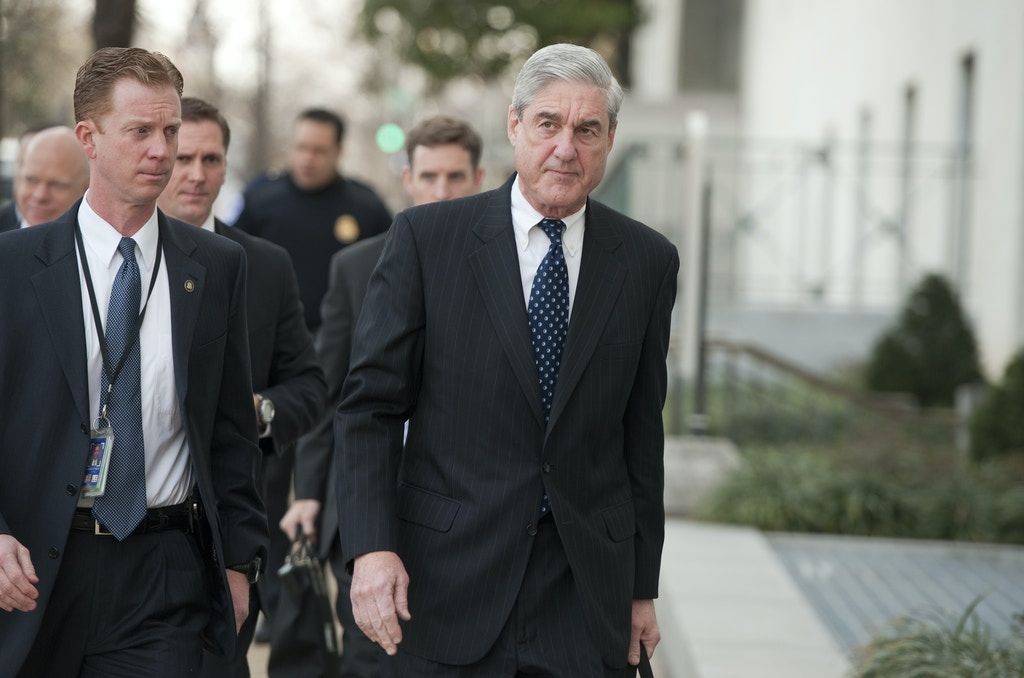 "UNITED STATES - JANUARY 31: FBI Director Robert Mueller, right, arrives on Capitol Hill to testify before a Senate (Select) Intelligence Committee hearing in Hart Building entitled ""World Wide Threats."" (Photo By Tom Williams/CQ Roll Call) (CQ Roll Call via AP Images)"