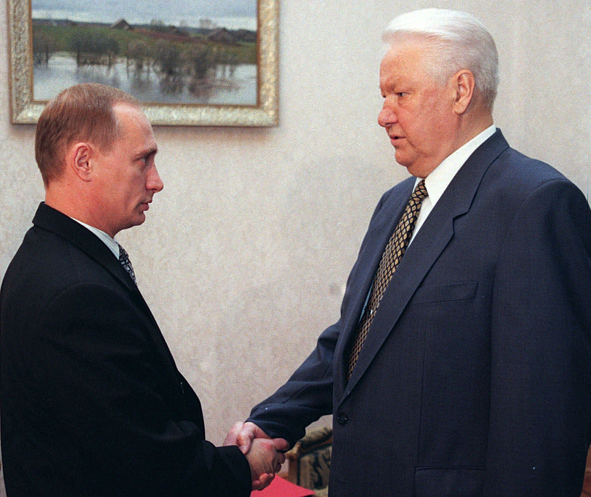 President Boris Yeltsin shakes hands with Vladimir Putin, the head of the Federal Security Service, at a country residence near Moscow, Friday, November 20, 1998. The Kremlin waffled Friday on whether Boris Yeltsin will visit India next month, two days after reviving speculation about his ailing health by saying he had canceled the trip. (AP Photo/ITAR-TASS)