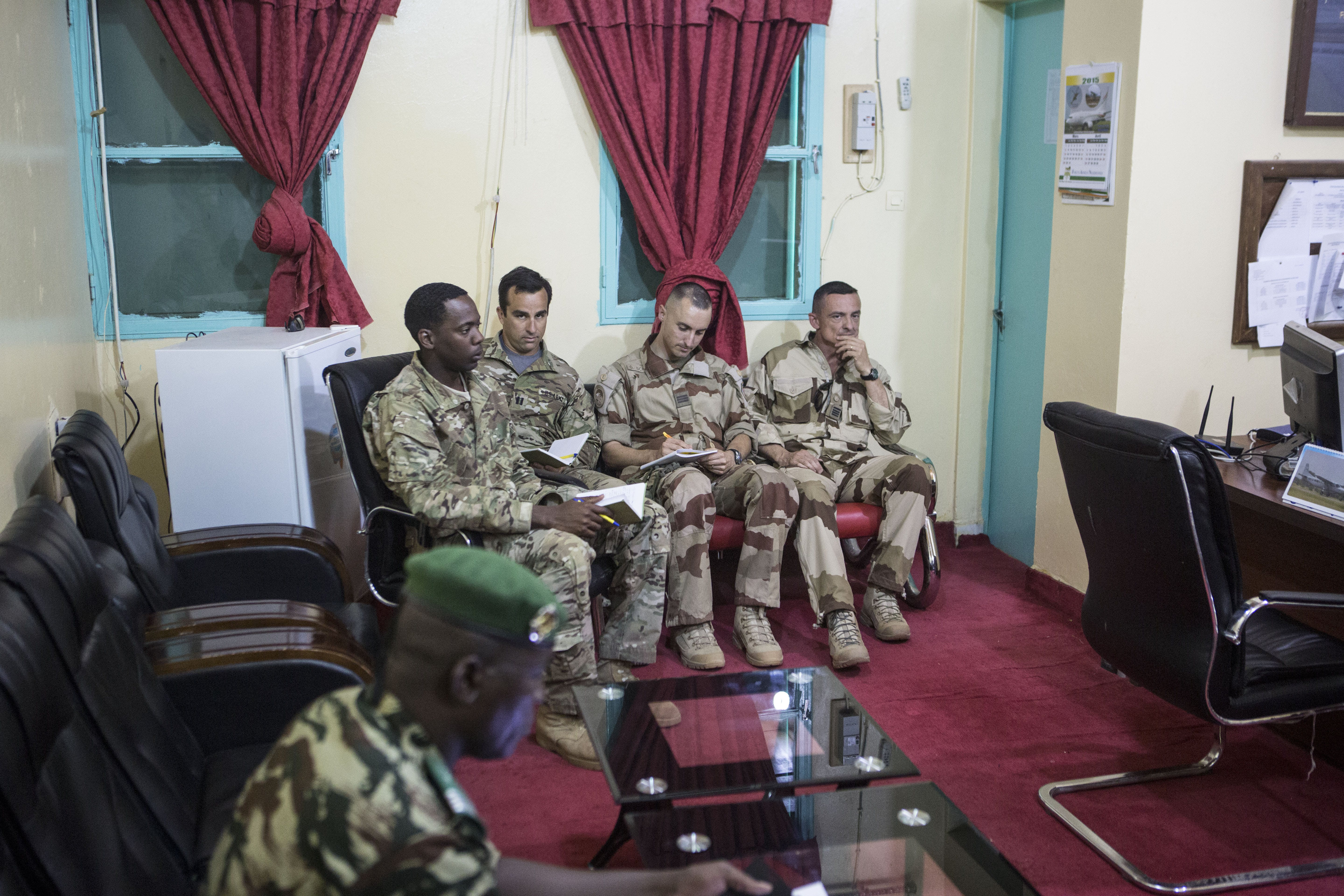 American and French soldiers attend a daily briefing with the Nigerien military commander in charge of the fight against Boko Haram (not pictured) at a Nigerien military base in Diffa, Niger, March 26, 2015.