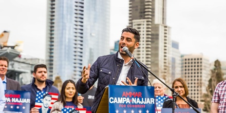 Ammar Campa-Najjar campaigns outside of the USS Midway Museum in San Diego, California on Feb. 11, 2017.