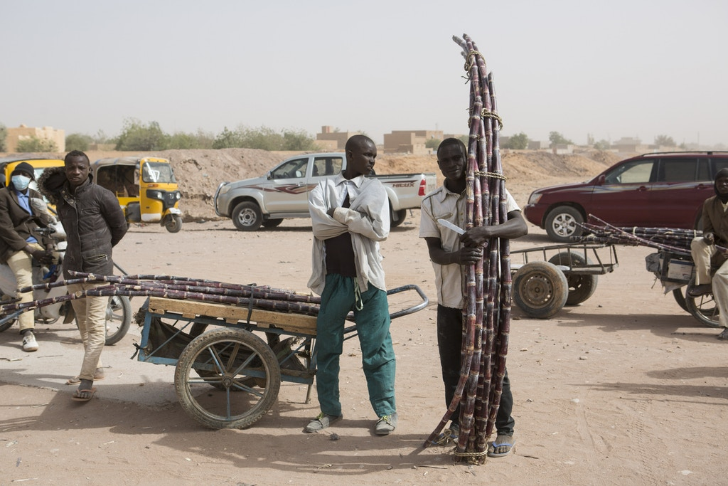 Sugar cane vendors stand outside during an official ceremony in Agadez, Niger, January 15, 2018.