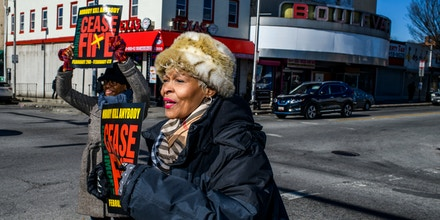 Baltimore, Maryland - February 03, 2018: Sonja Merchant-Jones attends a Remembrance Ceremony at the busy intersection of Waverly Village in Baltimore during the third Baltimore Ceasefire weekend Saturday February 3rd 2018.CREDIT: Matt Roth