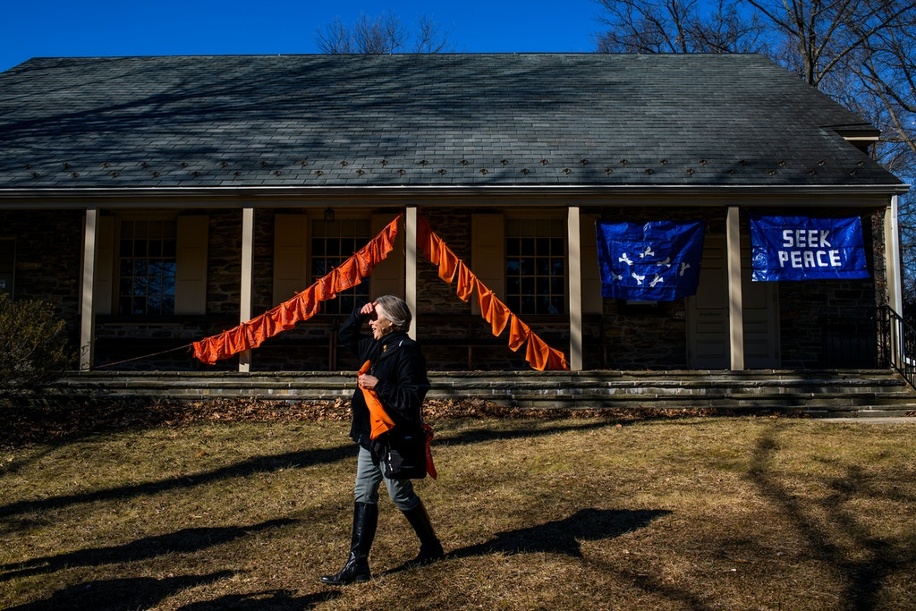 Baltimore, Maryland - February 03, 2018: Barbara Treasure stands in front of her Ceasefire Art Installation outside the Meeting House Stoney Run Meeting of Friends during the third Baltimore Ceasefire weekend, Saturday February 3rd, 2018.CREDIT: Matt Roth