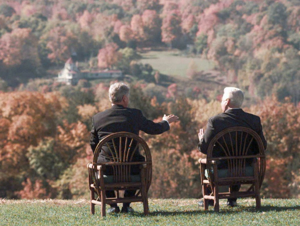 HYDE PARK, :  US President Bill Clinton (L) and Russian President Boris Yeltsin shown in a file photo dated 23 October 1995 looking at the fall foliage out over the Hudson River valley during their meeting at Hyde Park, New York. The two met to discuss the situation in Bosnia. (ELECTRONIC IMAGE) (Photo credit should read DON EMMERT/AFP/Getty Images)