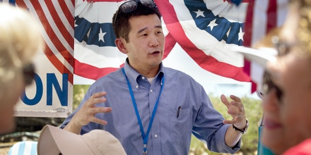 Dave Min, a Democratic candidate for Congress, campaigns at a street fair in Mission Viejo, Calif., July 4, 2017. Democratic efforts to take back control of the House may hinge on affluent suburban districts in Pennsylvania, Illinois and here in southern California, where many Republicans are leery of President Donald Trump. (Ivan Kashinsky/The New York Times)