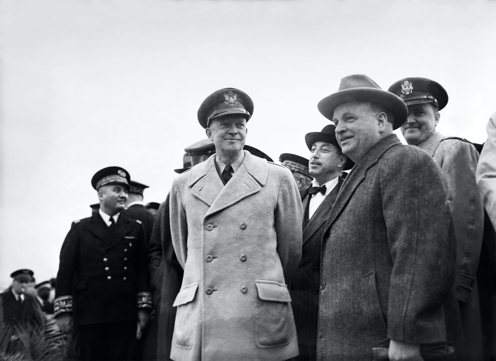 Picture released on May 18, 1951 at Reims  Champagne Air Base 112 of General Dwight D. Eisenhower (C), first Supreme Commander of NATO, welcomed by Georges Bidault (L), vice-president of Council and colonel Marcel Housset (R) to celebrate the arrival of F-84 Thunderjet in France, during the Military assistance program, in Reims. / AFP / -        (Photo credit should read -/AFP/Getty Images)