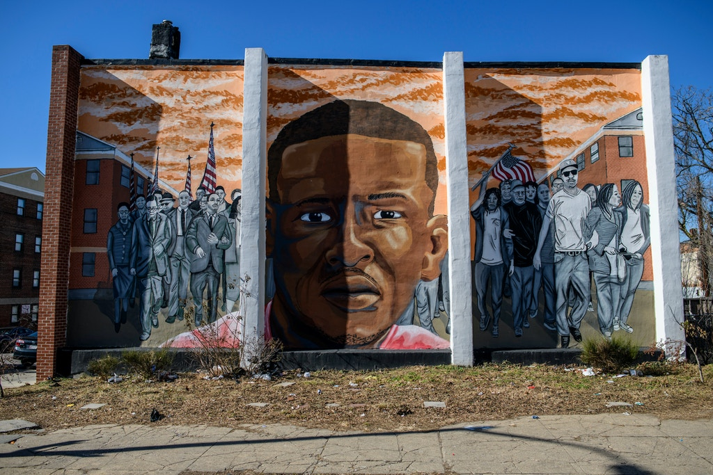 Baltimore, Maryland - February 03, 2018: A mural for Freddie Gray is seen at the intersection of North Mount and Presbury streets a block from where he was arrested in April 2015. His death while incarcerated by the Baltimore City Police sparked both peaceful protests and violent reactions in the city, most notably the Sandtown Winchester neighborhood where he was arrested. Since his arrest, Baltimore's homicide rate has spiked to record levels. The Baltimore Ceasefire movement, which held its third weekend of events promoting no gun violence in Baltimore February 2-4, is one of the peace movements that came about after Freddie Gray's death. CREDIT: Matt Roth