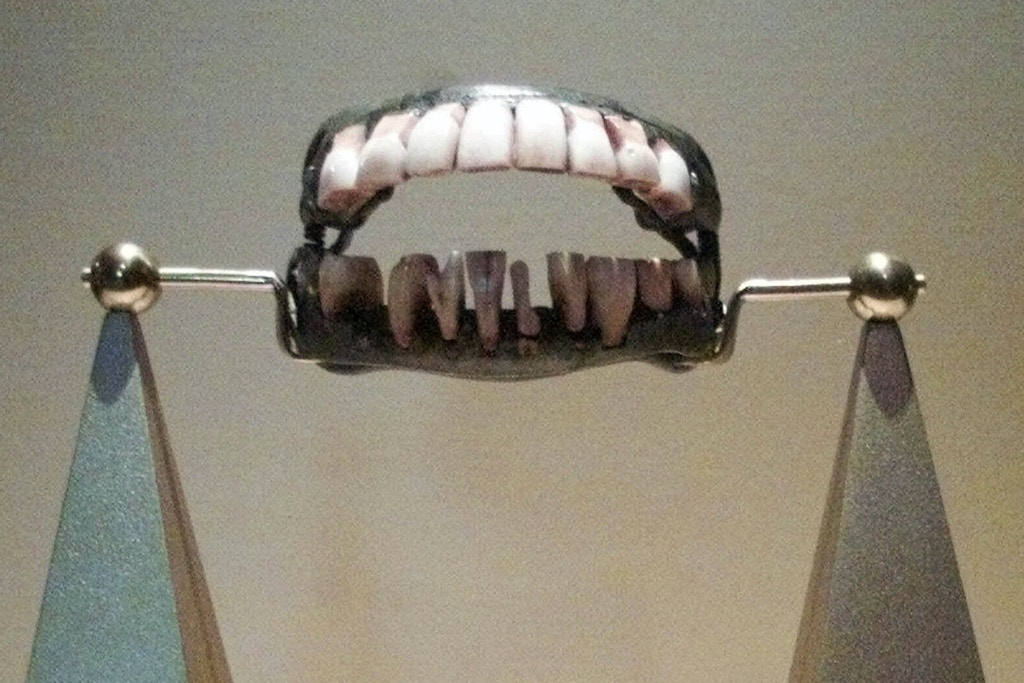George Washington's dentures are shown after their installation into a display at the Heinz Regional History Center in Pittsburgh, Monday, July 24, 2000. The teeth, part of a temporary exhibit on George Washington at the museum that opens on Saturday, July 29, are not carved from wood, but made with human and cow teeth according to Mount Vernon Estate collections manager Rebecca Eddins. (AP Photo/Keith Srakocic)