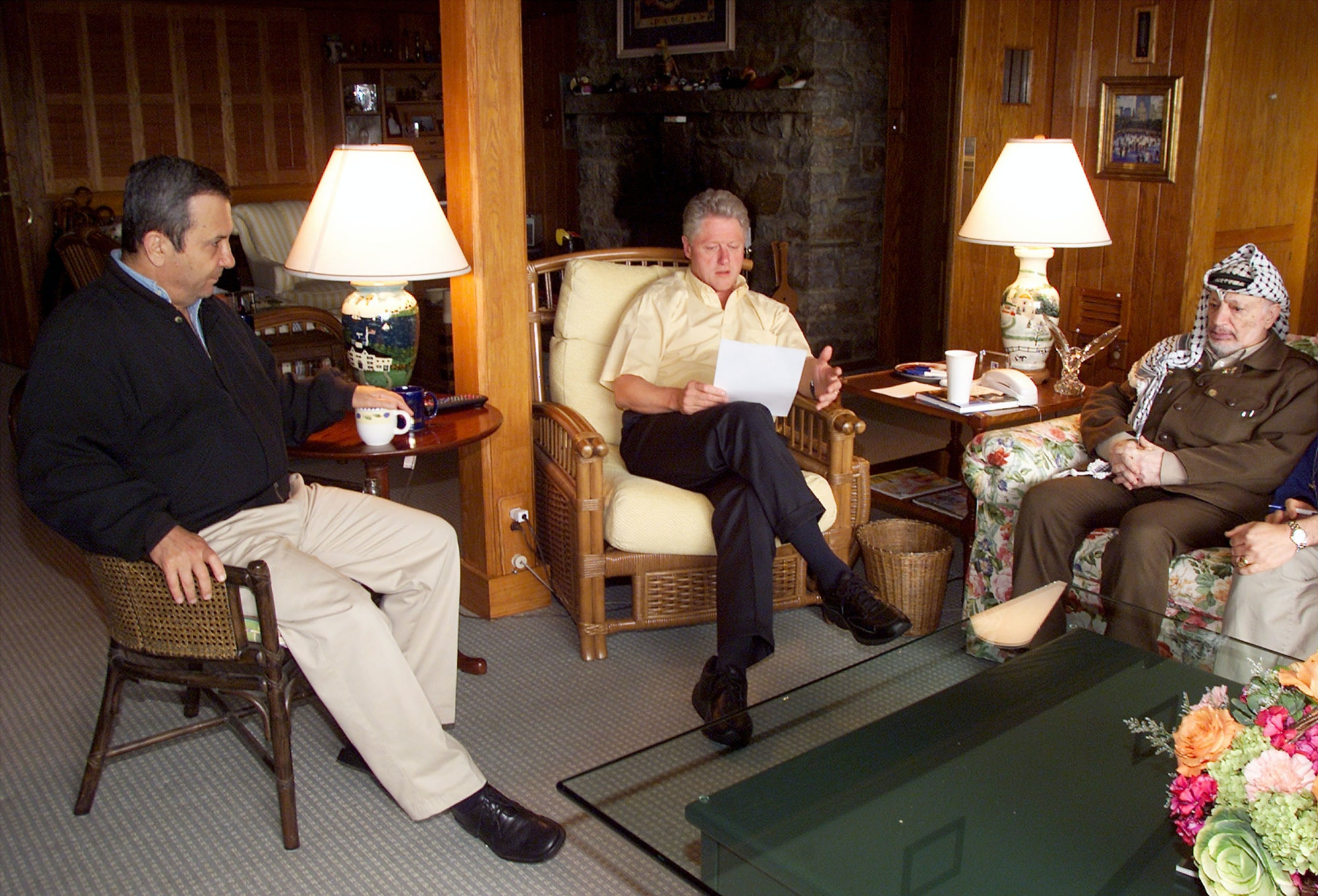 374228 01: U.S. President Bill Clinton, center, speaks during a morning meeting with Israeli Prime Minister Ehud Barak, left, and Palestinian Chairman Yasser Arafat July 25, 2000 at Camp David in Maryland. Clinton announced later in the day that the Middle East peace summit had collapsed because of a deadlock over the status of the disputed city of Jerusalem. (Photo by Ralph Alswang/Newsmakers)