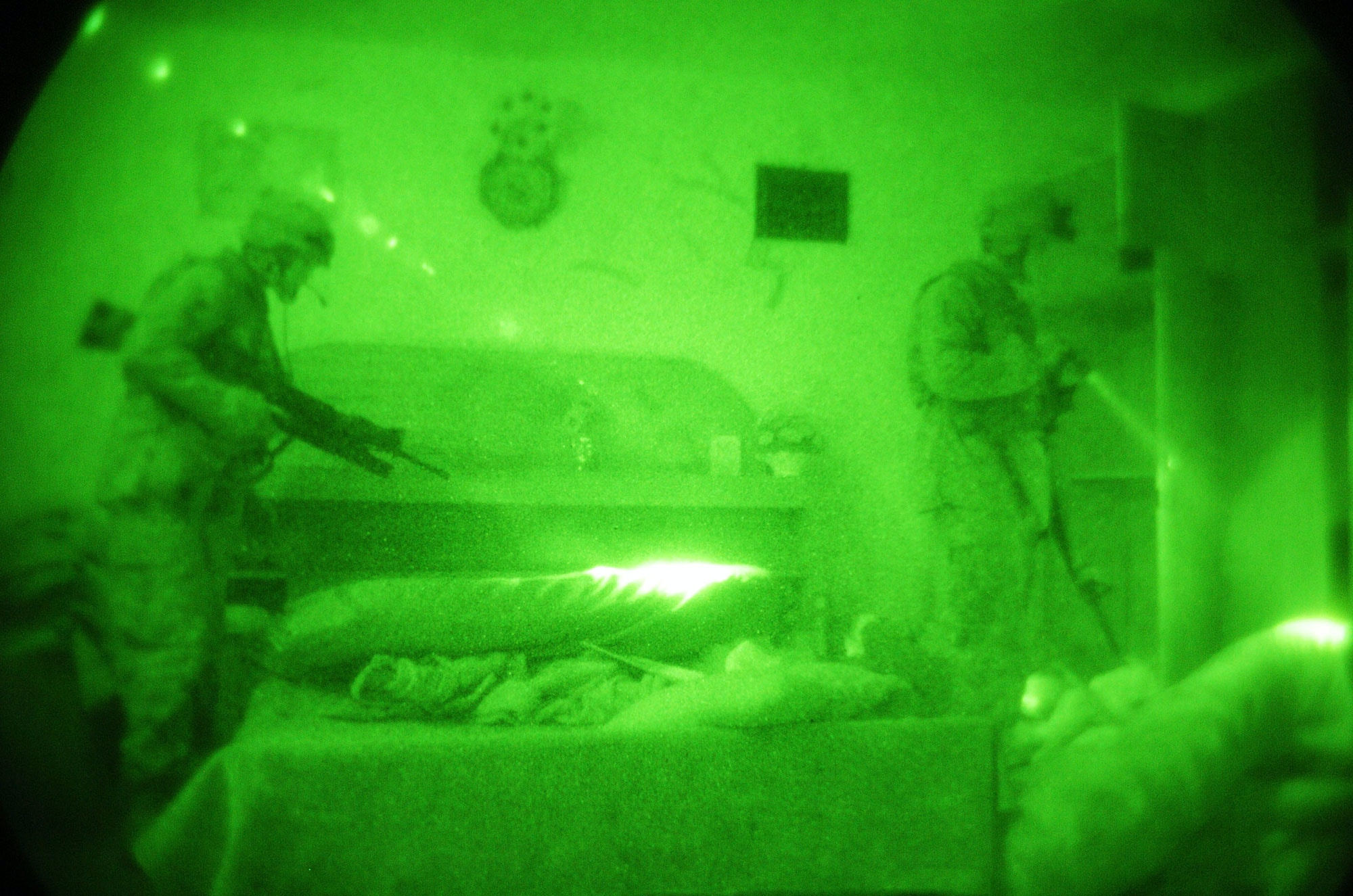 "HASWAH, IRAQ - OCTOBER 8:  U.S. Marines of the 1st Battalion 2nd Marines inspect the bedroom of a suspect, while patroling October 8, 2004 in the insurgent stronghold of Haswah, 25 miles south of Baghdad, Iraq. The patrol is part of a new Marine offensive called ""Operation Phantom Fury"", aimed at cutting off supply lines for Iraqi insurgents that shift cash, weapons, car bombs and militants from Fallujah and Ramadi to Baghdad. The operation is part of a wider U.S. assault on insurgent strongholds across Iraq before elections in January.  (Photo by Scott Peterson/Getty Images)"