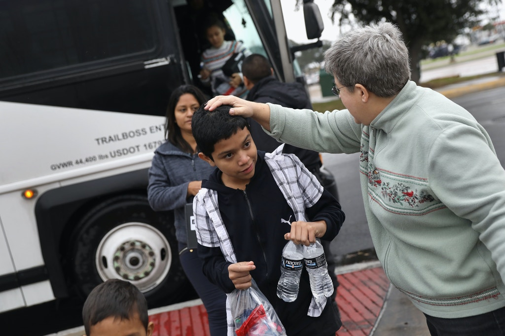 MCALLEN, TX - JANUARY 06:  Immigrants are released from U.S. immigration agents and greeted by Catholic Charities workers on January 6, 2017 at the Sacred Heart Catholic Church in McAllen, Texas. The Catholic Charities Respite Center helps thousands of immigrants, many having crossed illegally from Mexico into the United States to seek asylum. Most families are from Central America and are first detained by the U.S. Border Patrol, who process them and release them for their onward journey to cities around the United States. They are required to appear in immigration court at a later date for their cases to be heard.  (Photo by John Moore/Getty Images)