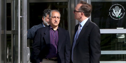 Ahmad Sheikhzadeh (C), a consultant to the Iranian mission to the United Nation, leaves Brooklyn Federal Court in New York, March 23, 2016. Sheikhzadeh, 60, is accused of charges related to sanctions violations, money laundering and tax matters, his lawyer Steve Zissou said at the hearing. REUTERS/Pearl Gabel - GF10000358057