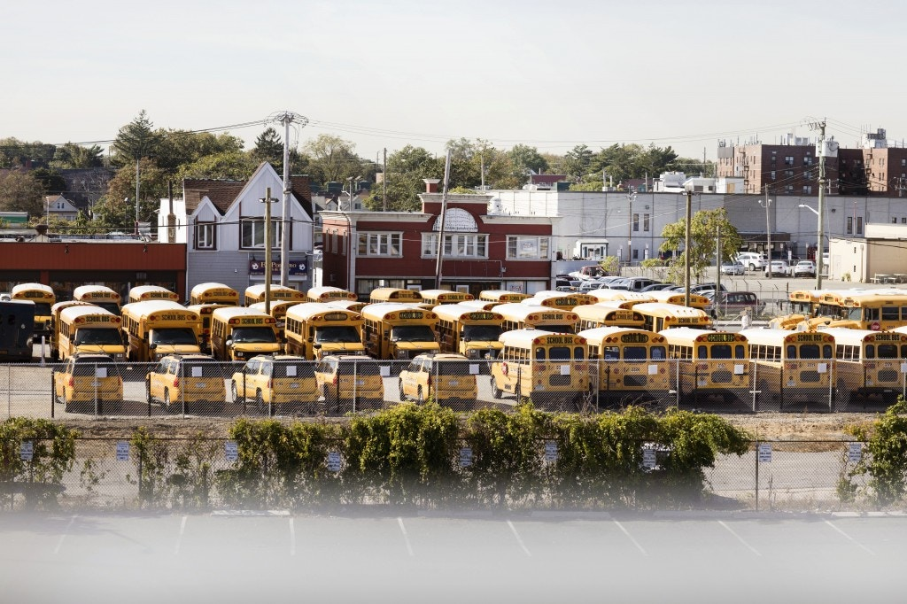 School buses sit in a parking lot in Hempstead, Long Island on Oct. 19, 2017.