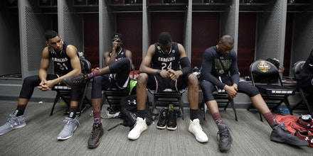 South Carolina players sit in the locker room after the semifinals of the Final Four NCAA college basketball tournament against Gonzaga, Saturday, April 1, 2017, in Glendale, Ariz. Gonzaga won 77-73. (AP Photo/Mark Humphrey)