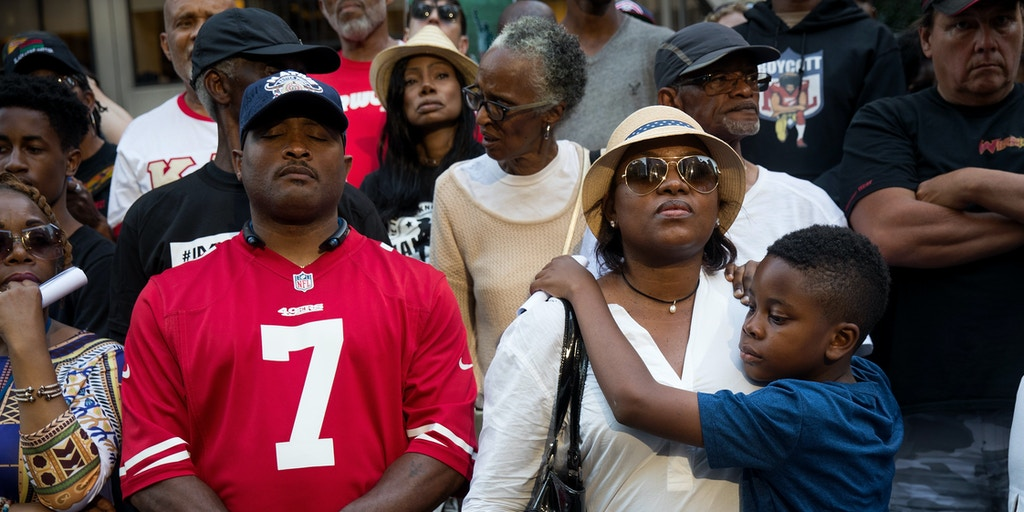 NEW YORK, NY - AUGUST 23: Activists listen to a speaking program during a rally in support of NFL quarterback Colin Kaepernick outside the offices of the National Football League on Park Avenue, August 23, 2017 in New York City. During the NFL season last year, Kaepernick caused controversy by kneeling during the National Anthem at games to protest racial oppression and police brutality. Kaepernick is currently a free agent and some critics and analysts claim NFL teams don't want to sign him due to his public display of his political beliefs. (Photo by Drew Angerer/Getty Images)
