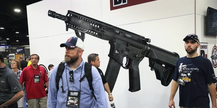 ATLANTA, GA - APRIL 29:  National Rifle Association members visit exhibitor booths at the 146th NRA Annual Meetings & Exhibits on April 29, 2017 in Atlanta, Georgia. With more than 800 exhibitors, the convention is the largest annual gathering for the NRA's more than 5 million members.  (Photo by Scott Olson/Getty Images)