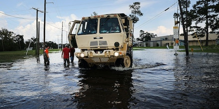 ORANGE, TX - SEPTEMBER 05:  Members of the Texas National Guard drive through the streets of Orange as Texas slowly moves toward recovery from the devastation of Hurricane Harvey on September 5, 2017 in Orange, Texas. Almost a week after Hurricane Harvey ravaged parts of the state, some neighborhoods still remained flooded and without electricity. While downtown Houston is returning to business, thousands continue to live in shelters, hotels and other accommodations as they contemplate their future.  (Photo by Spencer Platt/Getty Images)