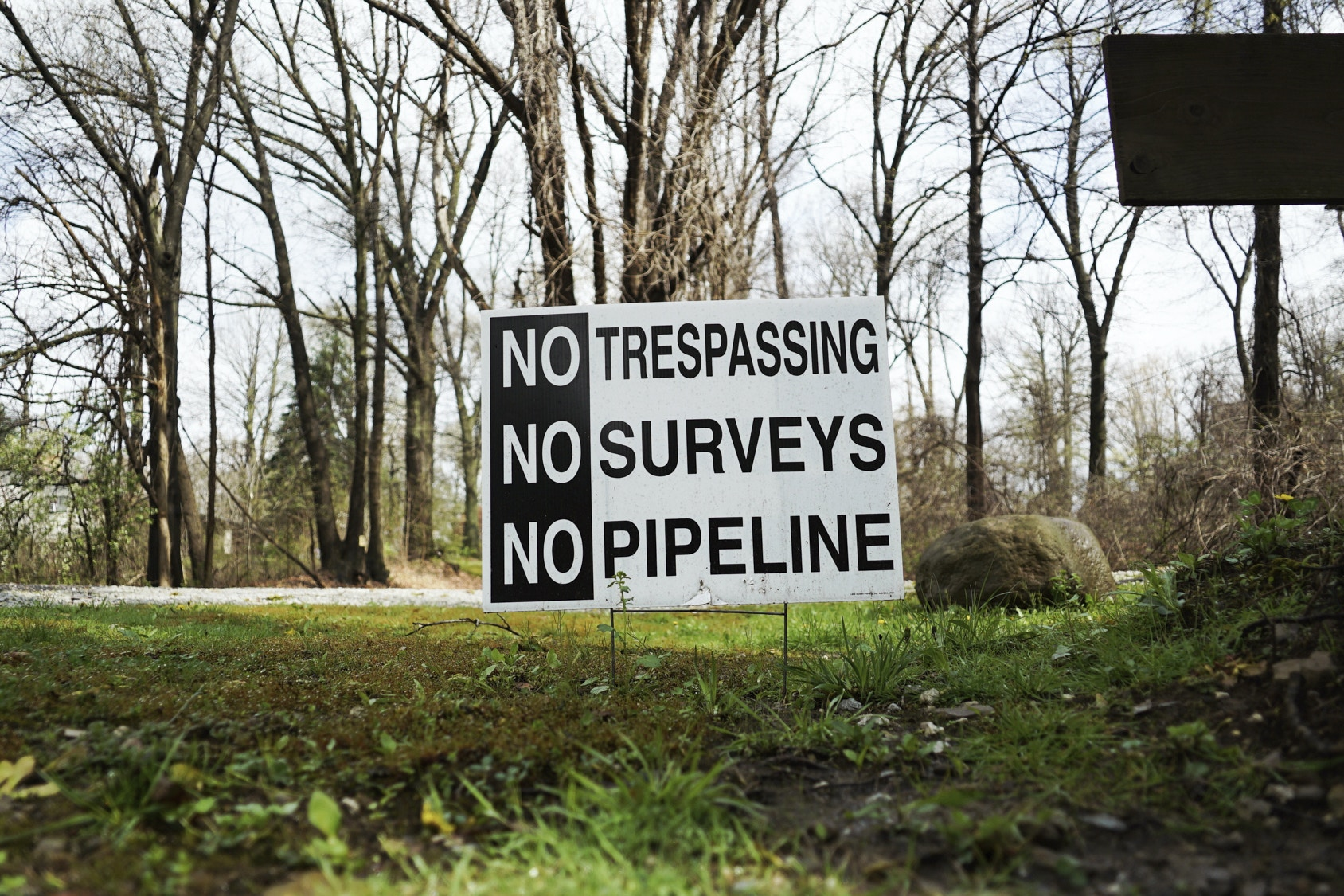 In this April 20, 2017 photo, a sign opposing a proposed pipeline sits in the front yard of a house in Green, Ohio. The town has hired a law firm to stop the pipeline from being built through the community. (AP Photo/Dake Kang)