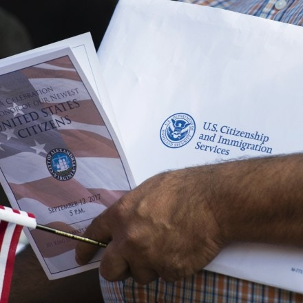 A new US citizen holds an information packet at a naturalization ceremony at Alexandria City Hall in Alexandria, Virginia on September 12, 2017.Each year, the United States Citizenship and Immigration Services (USCIS) welcomes approximately 680,000 citizens during naturalization ceremonies across the United States and around the world. / AFP PHOTO / ANDREW CABALLERO-REYNOLDS (Photo credit should read ANDREW CABALLERO-REYNOLDS/AFP/Getty Images)