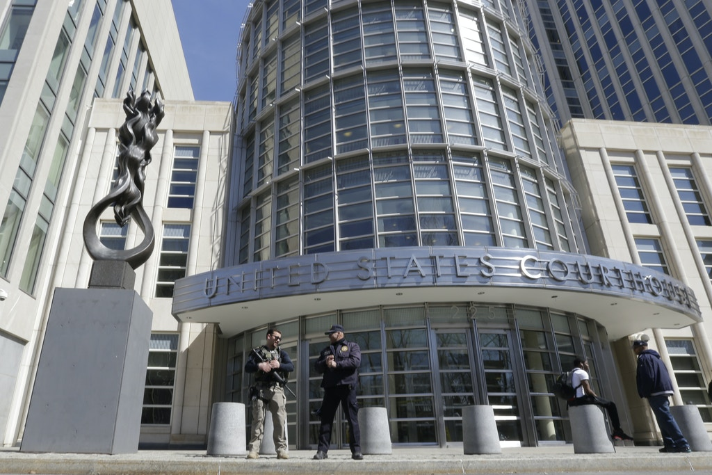 Heavily armed U.S. Marshals stand guard outside federal court Thursday, April 2, 2015, in the Brooklyn borough of New York. A U.S. citizen who authorities say traveled from Canada to Pakistan to train with al-Qaida in order to carry out jihad has been arrested and charged with conspiring to kill American soldiers, according to court papers unsealed Thursday. (AP Photo/Mary Altaffer)