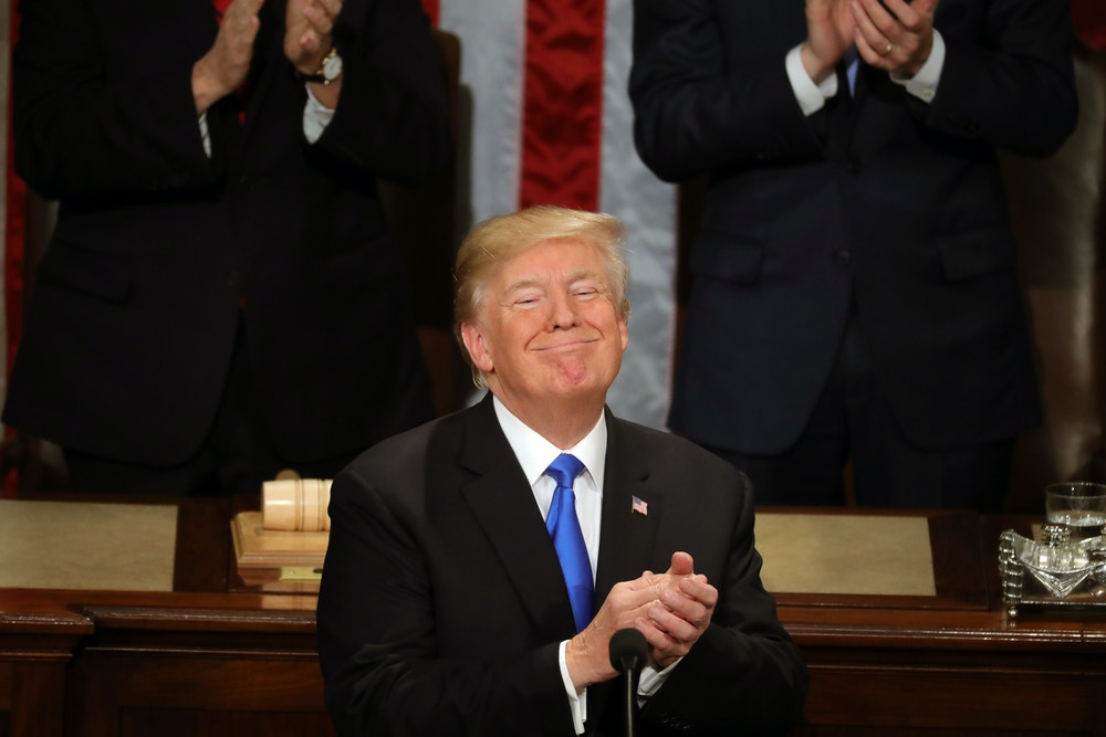 WASHINGTON, DC - JANUARY 30:  U.S. President Donald J. Trump claps during the State of the Union address in the chamber of the U.S. House of Representatives January 30, 2018 in Washington, DC. This is the first State of the Union address given by U.S. President Donald Trump and his second joint-session address to Congress.  (Photo by Chip Somodevilla/Getty Images)