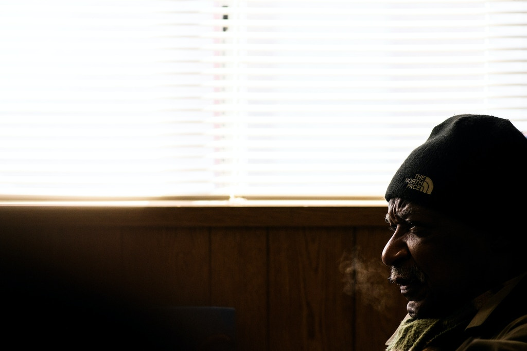 Baltimore, Maryland - February 03, 2018: Tubman House board member Eddie Conway sits for a group interview in the group's temporary trailer Saturday February 3rd, 2017. The original Tubman House was demolished two days earlier. They gathered for an interview to discuss violence in Baltimore and the third Baltimore Ceasefire weekend. CREDIT: Matt Roth