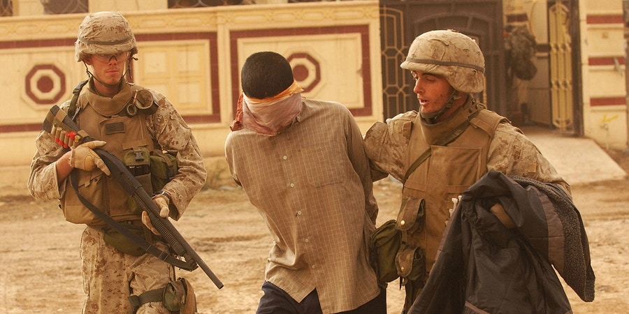 FALLUJAH, IRAQ - NOVEMBER 23:  U.S. Marines escort nine detainees captured in Fallujah, half of them from other countries such as Yemen, Saudi Arabia and Gulf states, to a local