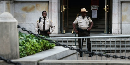 BALTIMORE, MD - SEPTEMBER 02:  City Sheriff's deputies stand guard in front of the Baltimore City Circuit Courthouse East where pre-trial hearings will be held for six police officers charged in the death of Freddie Gray September 2, 2015 in Baltimore, Maryland. Earlier this year Gray, 25, suffered a severe spinal cord injury while in police custody and later died. His funeral was followed by rioting, looting and arson.  (Photo by Chip Somodevilla/Getty Images)