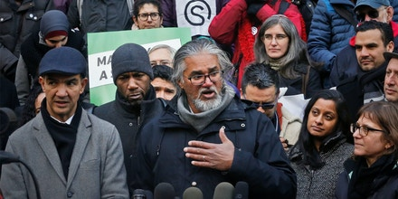 Ravi Ragbir, center, a citizen of Trinidad and Tobago and executive director of the New Sanctuary Coalition of New York City, speaks during a press conference held on his behalf, as he fights deportation Wednesday Jan. 31, 2018, at New York City Hall. Council members Jumaane Williams, front far left, and Ydanis Rodriguez, front second from left, were arrested as they attempted to block authorities from taking Ragbir into custody on Jan. 11 after a routine check-in with immigration officials in New York. A federal judge on Monday ordered authorities to immediately release Ragbir on the grounds he hadn't been given enough time to say goodbye to his family. (AP Photo/Bebeto Matthews)
