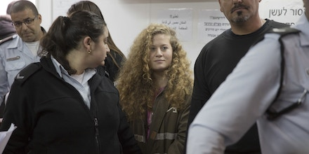 Ahed Tamimi in a courtroom inside the Ofer military prison near Jerusalem, Tuesday, Feb. 13, 2018. (AP Photo/Ariel Schalit)