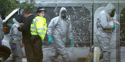 Members of the emergency services wearing biohazard protective suits, work at the London Road Cemetery in Salisbury, southern England, on March 10, 2018, where the wife and son of former Russian spy Sergei Skripal are buried.British soldiers were deployed on Friday to help a counter-terrorism investigation into a nerve agent attack on former Russian spy Sergei Skripal, as speculation mounted over how London could retaliate if the Russian state is found to be responsible. Skripal and his daughter Yulia remain unconscious in a critical but stable condition following the March 4 attack in the sleepy south-western English city of Salisbury. / AFP PHOTO / Daniel LEAL-OLIVAS (Photo credit should read DANIEL LEAL-OLIVAS/AFP/Getty Images)