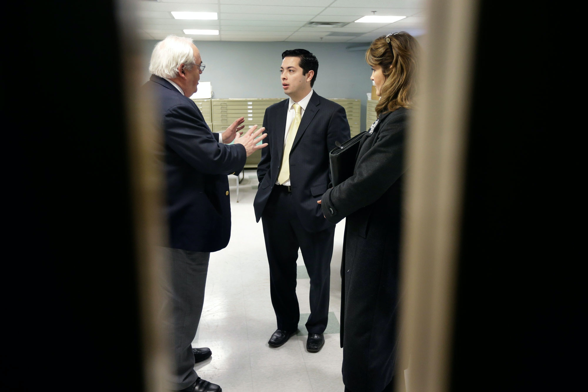 In this Jan. 29, 2013 photo Central Falls, R.I., Mayor James Diossa, center, speaks with President of the Northern Rhode Island Chamber of Commerce John Gregory, left, and Director of Regulatory Reform for R.I., Leslie Taito during a meeting at the Public Works building in Central Falls.  Diossa, the newly elected mayor of Central Falls, Rhode Island, is from a Colombian immigrant family and is the hope of a mainly Latino town that wants to move forward after being marred by corruption and bankruptcy. (AP Photo/Steven Senne)