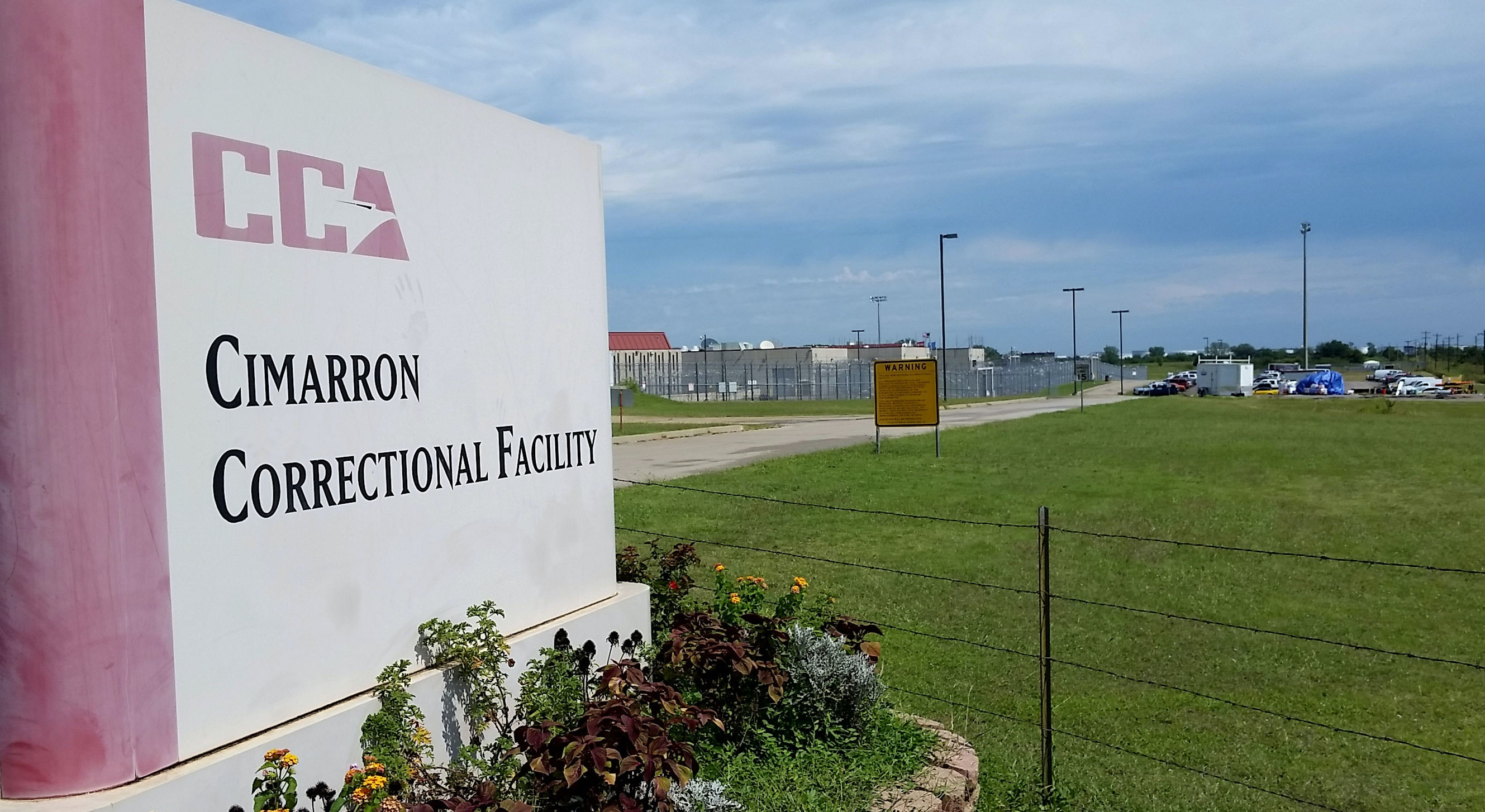 Cimarron Correctional Facility in Cushing, Oklahoma is seen in this Monday, Sept. 14, 2015 photo. The private prison where violence erupted over the weekend and left four inmates dead is one of three private facilities that house nearly 6,000 Oklahoma inmates. A rash of violence at these facilities is prompting questions about whether there is adequate staffing and oversight to prevent such episodes. (AP Photo/Kelly Kissel)