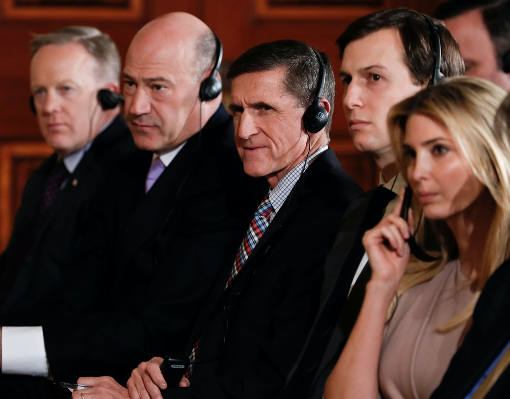 From left, White House press secretary Sean Spicer, National Economic Council chairman Gary Cohn, National Security Adviser Michael Flynn, senior adviser to President Donald Trump, Jared Kushner, and Ivanka Trump, the daughter of President Donald Trump listen to translation during a President Donald Trump, Japanese Prime Minister Shinzo Abe joint new conference in the East Room of the White House, in Washington, Friday, Feb. 10, 2017. (AP Photo/Carolyn Kaster)