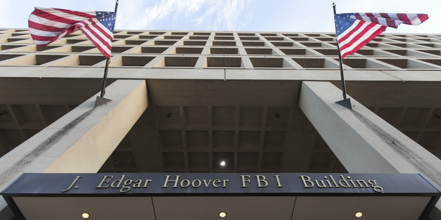 The Pennsylvania Avenue entrance of the J. Edgar Hoover Federal Bureau of Investigations (FBI) Building is seen in Washington, Thursday, Nov. 30, 2017. (AP Photo/Carolyn Kaster)