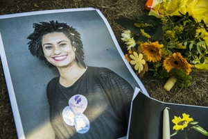 A makeshift memorial is pictured during a protest of Brazilian expats against the killing of Rio de Janeiro's left councilwoman and activist Marielle Franco in Berlin, Germany on March 18, 2018. Marielle Franco, who criticised openly racism and police brutality, was shot with his driver Anderson Pedro Gomes in the city center of Rio de Janeiro in the evening of March 14, 2018. (Photo by Emmanuele Contini/NurPhoto/Sipa USA)(Sipa via AP Images)